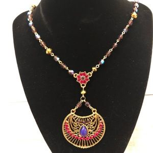 Multi color crystal necklace with decorative charm
